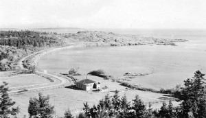 """Shoal Bay, Victoria, B. C."" The Green family cottage, McNeill (Shoal) Bay, Anderson Hill and McMicking Point from Gonzales Hill. Real-photo postcard, taken before subdivision of the McNeill estate, photographer unknown. From the collection of Dr. Richard Moulton."